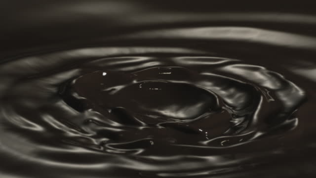 A vibrant ripple in dark liquid chocolate.