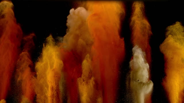 slo mo ld vibrant spices exploding into the air - spice stock videos & royalty-free footage