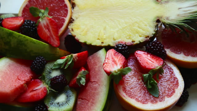 a vibrant variety of fruit - fruit salad stock videos & royalty-free footage