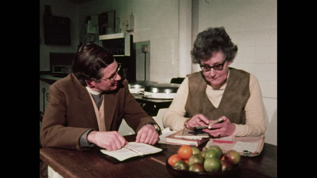 vicar and parishioner compare diaries, 1970s - diary stock videos & royalty-free footage