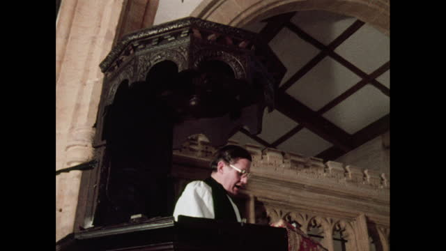 a vicar delivers a sermon from a pulpit, 1970s - priest stock videos & royalty-free footage