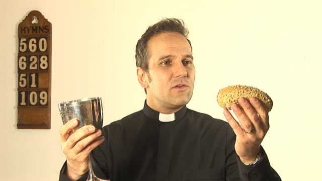 vicar / priest at communion in church service - minister clergy stock videos and b-roll footage