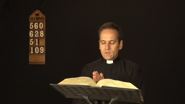 vicar / priest praying - hd & pal - minister clergy stock videos and b-roll footage