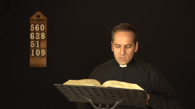 vicar / priest reading the bible - hd & pal - minister clergy stock videos and b-roll footage
