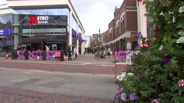 Vicarage Road stadium betting shop and Watford GVs ENGLAND Hertfordshire Watford EXT Shops on high street / intu Watford sign / Metro Bank / Traffic...