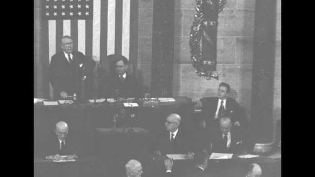 ms vice president alben barkley standing at podium next to house speaker joseph martin hands a man a document / ms barkley martin and men on dais... - alben w. barkley stock videos and b-roll footage