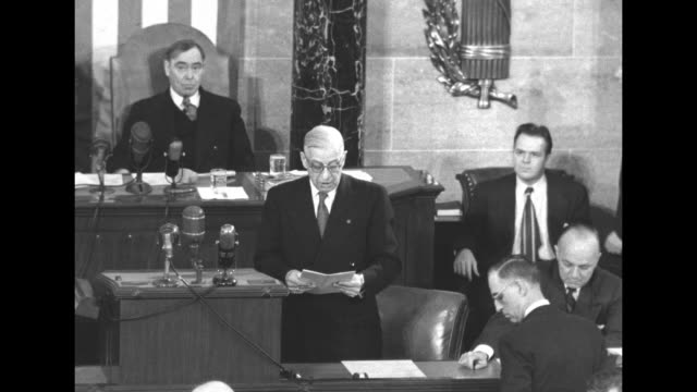 ms vice president alben barkley standing at podium next to house speaker joseph martin hands a man a document / man on dais in front of martin reads... - alben w. barkley stock videos and b-roll footage
