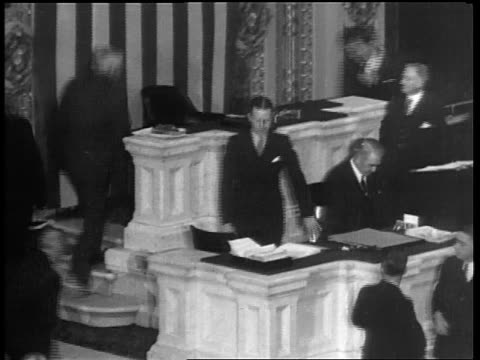 Vice President Garner ascending stairs shaking hands / House of Reps repeals prohibition