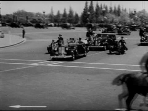 vice president herbert hoover president franklin d roosevelt sitting in open convertible car driving w/ secret service motorcade fdr top hats - 1939 stock videos & royalty-free footage