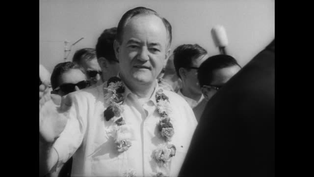 Vice President Hubert Humphrey at the beginning of his tour of South East Asia / helicopter lands in South Vietnam / Humphrey seated with others...