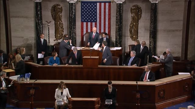 Vice President Joe Biden tells Pennsylvania Congressman Robert Brady under his breath to do well when he reads the certificate of election from...