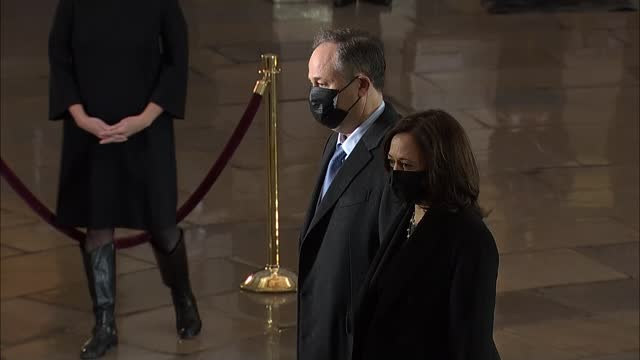 vice president kamala harris is accompanied by second gentleman doug emhoff to view memorial wreaths to late capitol police officer brian sicknick... - 光栄点の映像素材/bロール
