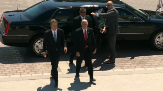 Vice President Mike Pence and Supreme Court nominee Judge Brett Kavanaugh emerge from vehicles at the Senate steps to greet Senators a day after his...