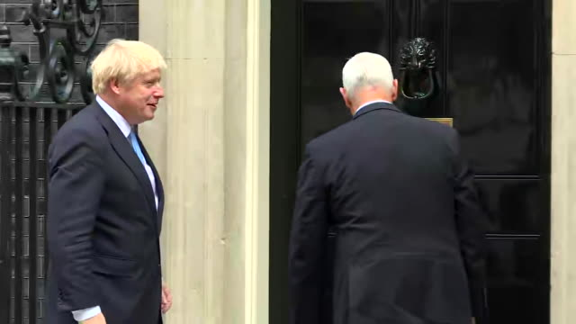 vice president mike pence greets and shakes hands with british prime minister boris johnson outside of 10 downing street in london, england. - united states and (politics or government) stock videos & royalty-free footage