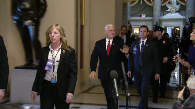 Vice President Mike Pence is seen walking with an entourage first by the Ohio clock outside the Senate chamber and then in route to the House chamber...