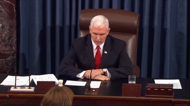 vice president mike pence presides over the senate asking whether the senate would recede from its amendment to the tax cuts and jobs act concurring... - senate stock videos & royalty-free footage