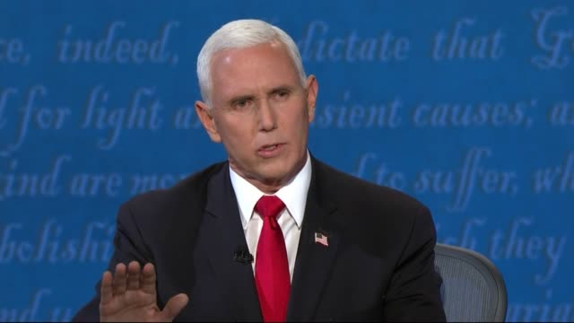 vice president mike pence responds to california senator kamala harris in televised debate about a claim of having lost a trade war with china but... - paris agreement stock videos & royalty-free footage