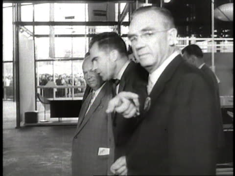 vice president richard nixon and premier nikita khrushchev tour the american national exhibition - 冷戦点の映像素材/bロール