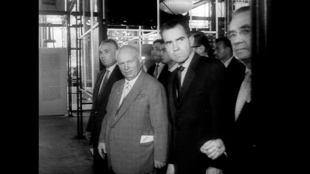 / vice president richard nixon and soviet chief nikita khrushchev at the united states fair in moscow / nixon and khrushchev debate standing next to... - 1959 stock-videos und b-roll-filmmaterial