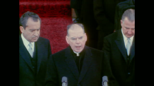 vice president spiro agnew and president nixon stand as archbishop terence cooke gives prayer - präsidenten amtseinführung stock-videos und b-roll-filmmaterial