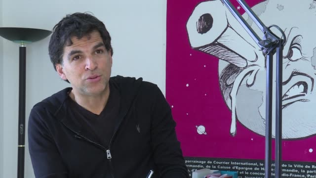 vice-president of the cartooning for peace foundation and new york times swiss cartoonist patrick chappatte reacts to the news that his turkish... - cartoonist stock videos & royalty-free footage