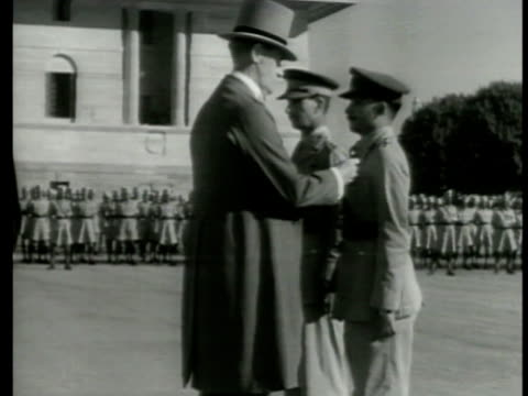 viceroy of india lord linlithgow outdoor ceremony pinning medal on indian soldier's uniform chest cu victoria cross medal viceroy shaking hands w/... - linlithgow stock videos and b-roll footage
