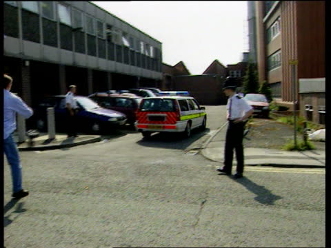 vicky fletcher murder suspect arrested england west yorkshire pontefract police car along at speed and into pontefract police station pan - west yorkshire stock-videos und b-roll-filmmaterial