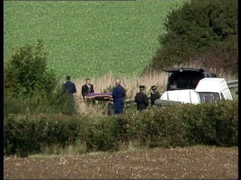 vídeos de stock e filmes b-roll de vicky hall's body found itn suffolk creeting st mary body carried away from inflatable tent over area where body of teenager vicky hall was found... - encontrar