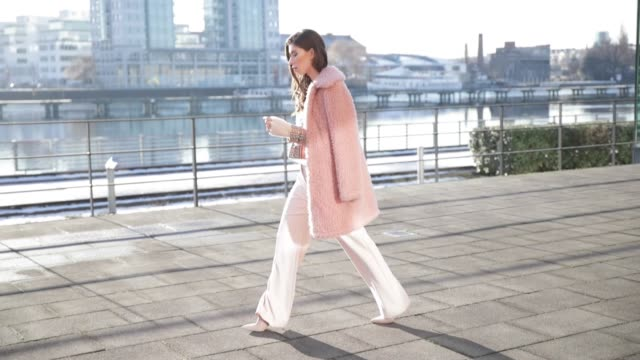 Vicky Heiler wearing a pink teddy coat Marc Cain white creme Marc Cain wide leg pants knit during the MercedesBenz Fashion Week Berlin A/W 2017 on...