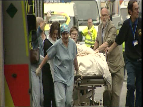 Victim of London 7/7 bombings transported to safety on stretcher 2005