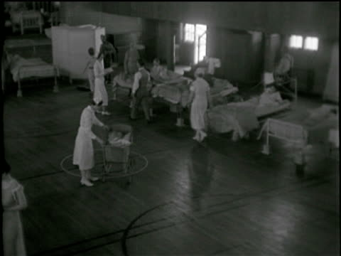 / victim of sandstorm being carried into hospital / interior of emergency ward nurses taking care of victims / nurse helping children fitting face... - saskatchewan stock videos and b-roll footage