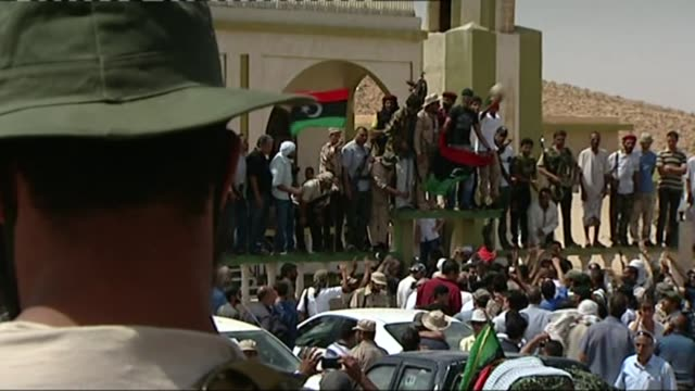 victims' anger at tony blair comments on compensation; tx 6.9.2011 / t06091104 libya: bani walid: rebel fighters holding libyan flag and chanting... - rebellion stock videos & royalty-free footage