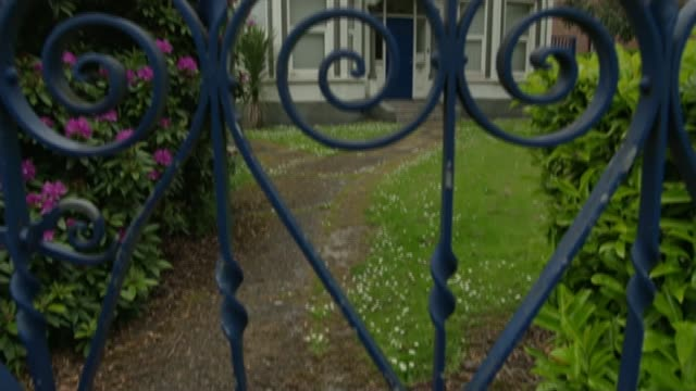 victims call for abuse at kincora boys' home to be included in historic child abuse inquiry; reporter to camera former kincora boys' home number... - letterbox stock-videos und b-roll-filmmaterial