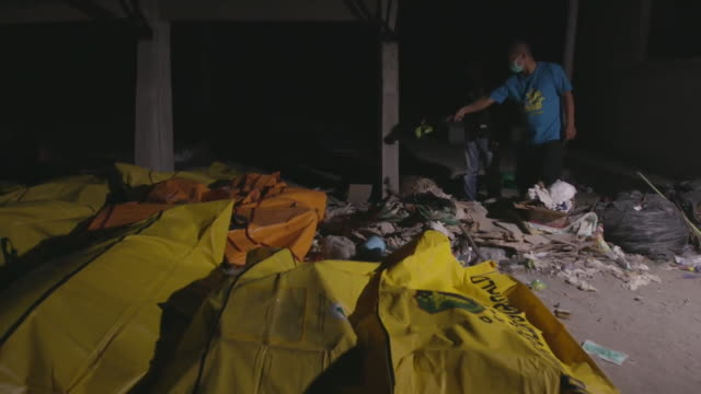 victims of a devastating tsunami in palu indonesia lying in bodybags - victim stock videos & royalty-free footage
