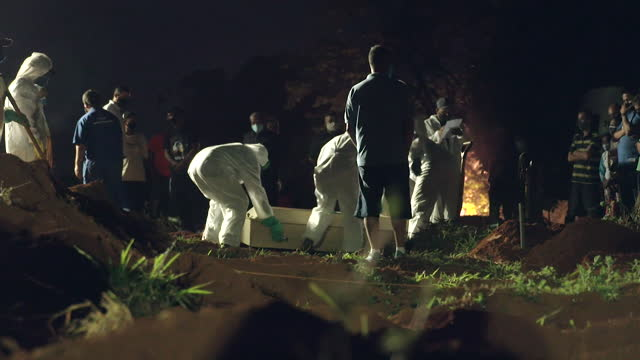 victims of coronavirus being buried at night in sao paulo - cemetery stock videos & royalty-free footage