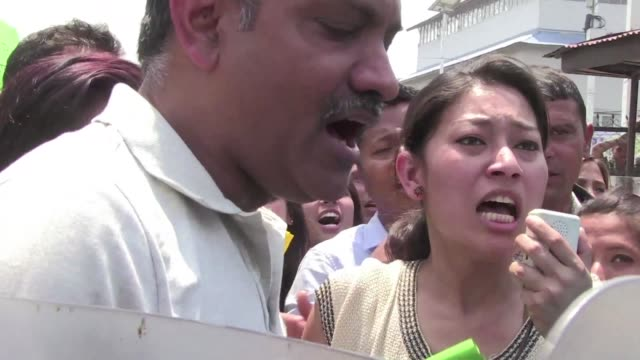 victims of the earthquake protest against the lack of reconstruction work by the nepali government on the one year anniversary of the disaster - rebuilding stock videos and b-roll footage