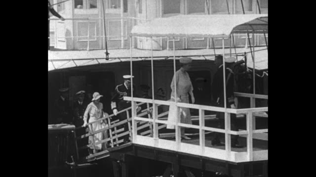 HMY Victoria and Albert steams into Southampton / Queen Mary walks up gangplank with George following / SOT George 'the welfare of this country is...