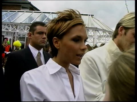 kidnap attempt arrests lib pop star victoria beckham signing autographs next husband david beckham outside venue of birthday party of their son... - 2002 bildbanksvideor och videomaterial från bakom kulisserna