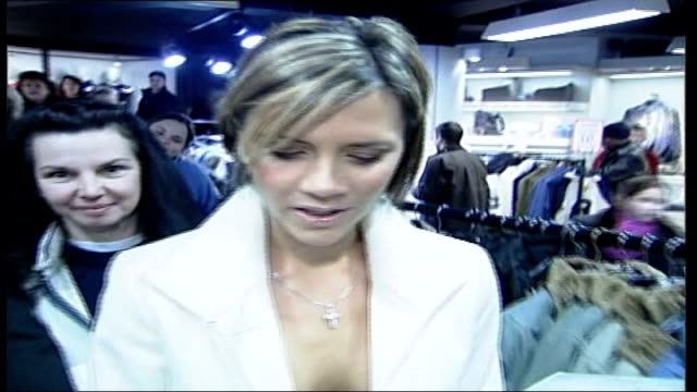 Kidnap attempt Arrests LIB Victoria Beckham along thru shop signing autographs