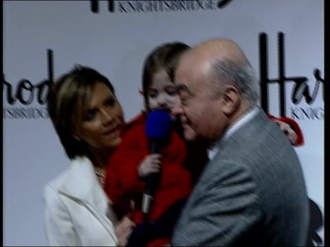 victoria beckham opens harrods sale; itn int cheque for 20,000 pounds handed by victoria to kirsty, held by al-fayed victoria, kirsty and al-fayed... - ronan keating stock videos & royalty-free footage