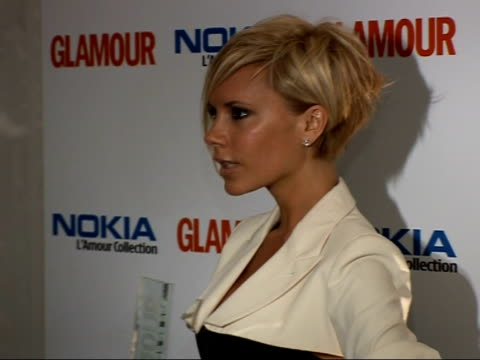 victoria beckham wins at glamour magazine awards photocalls and interviews ****flash victoria beckham posing for photocall with award / victoria... - corset stock videos & royalty-free footage