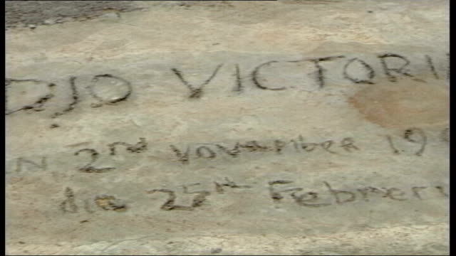 victoria climbie death: inquiry report released; lib ivory coast: ext grave of victoria climbie - côte d'ivoire stock videos & royalty-free footage