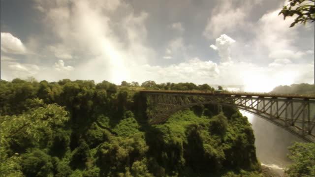 victoria falls bridge spans a gorge over the zambezi river. - victoria falls stock videos and b-roll footage