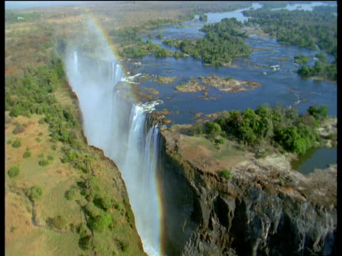 victoria falls with rainbow - victoria falls stock videos and b-roll footage