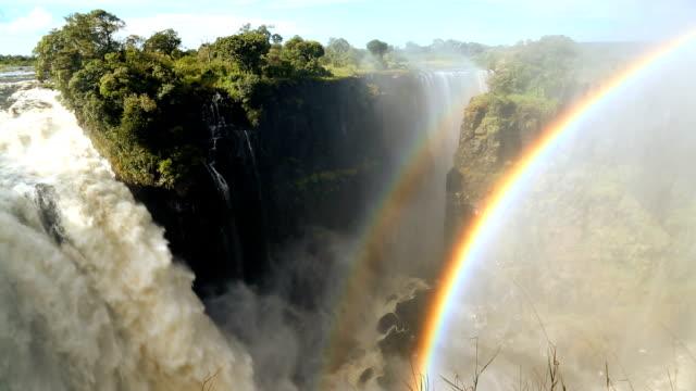victoria falls zimbabwe africa waterfall rainbow zambezi river - victoria falls stock videos and b-roll footage