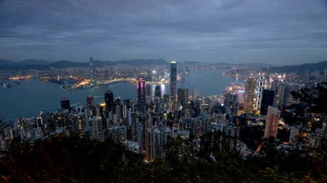 stockvideo's en b-roll-footage met victoria harbour and hong kong skyscraper building illumination from the peak in winter - hong kong