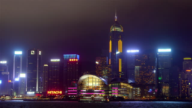 victoria harbour at night - central plaza hong kong stock videos & royalty-free footage