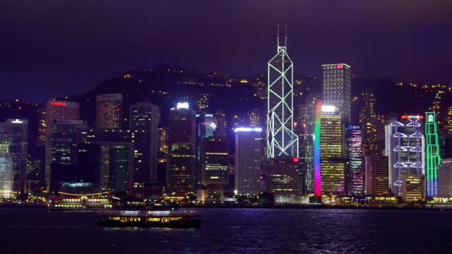 victoria harbour at night - bank of china tower hong kong stock videos and b-roll footage