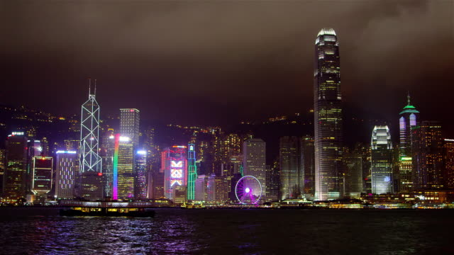 victoria harbour at night - hsbc main building stock videos and b-roll footage