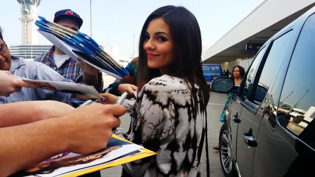 victoria justice signs autographs at los angeles international airport in celebrity sighting in los angeles 1/08/2015 - autographing stock videos & royalty-free footage